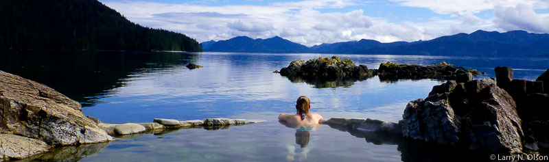 Woman relaxes in hot spring at Hot Springs Island, Haida Gwaii, BC Canada