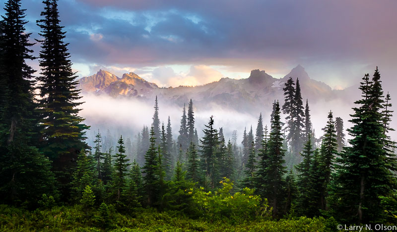 Sunset illuminates the Tatoosh Range during a clearing storm.